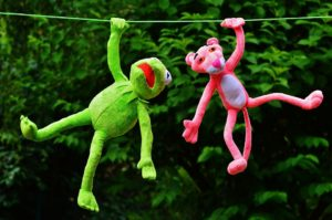 Two puppet friends hanging out on a washing line