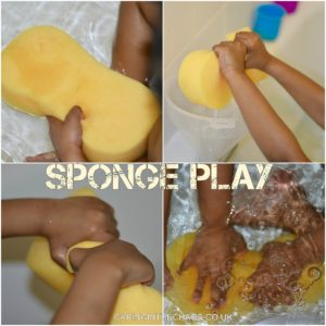 child playing in the bath with large sponge